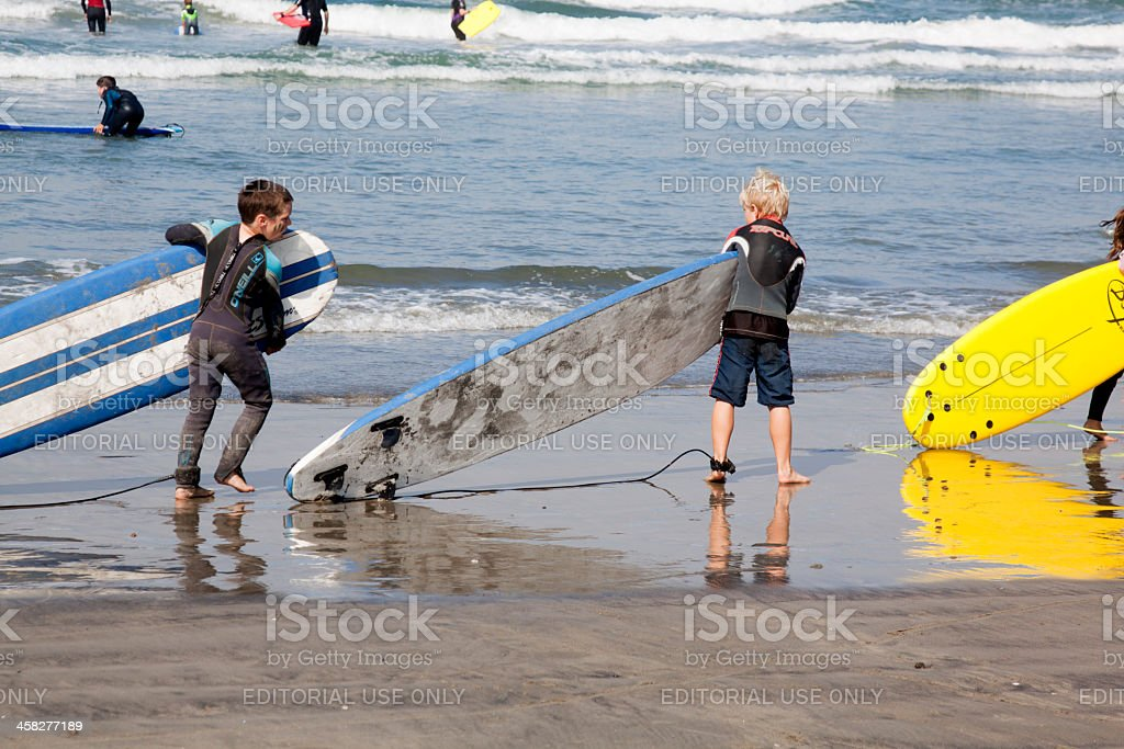 Three Young Surfers royalty-free stock photo