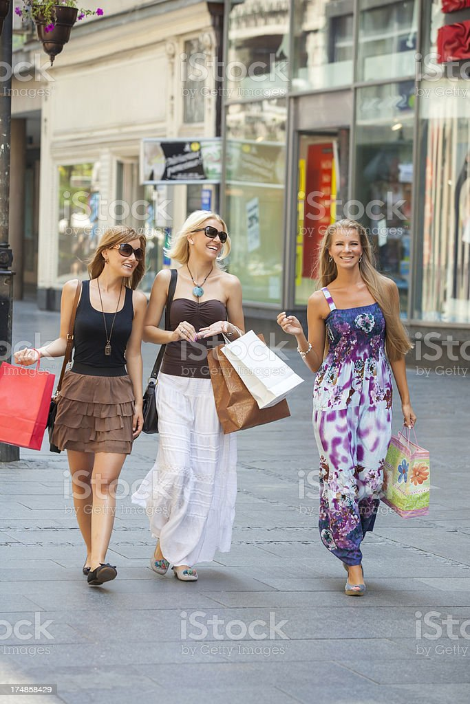 Three young woman on th street royalty-free stock photo