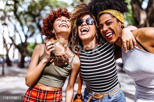 700702502istockphoto Three young women enjoying in city 1191028311