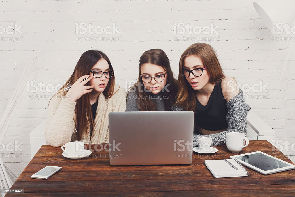 Three young women friends with laptop. royalty-free stock photo