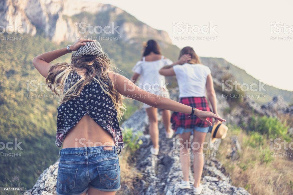 Three young women go to viewpoint stock photo