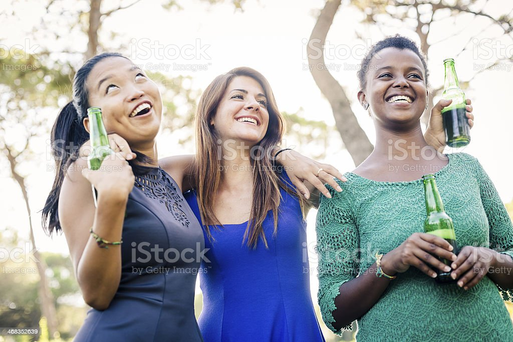 Three young women having fun at the park royalty-free stock photo