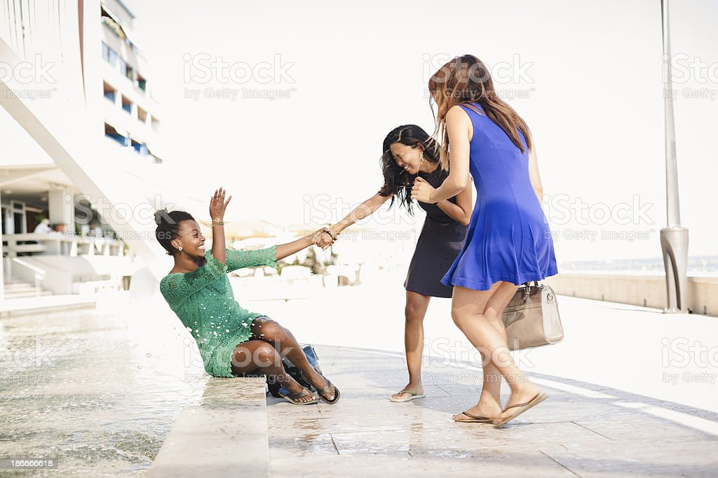 Three young women having fun in the city royalty-free stock photo