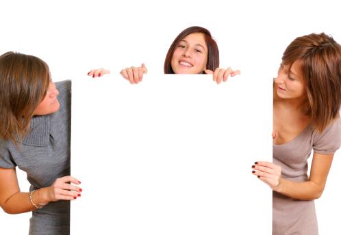 1166716628 istock photo Three Young Women Holding Blank Billboard 155914377