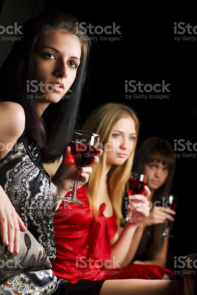 Three young women in a night bar royalty-free stock photo