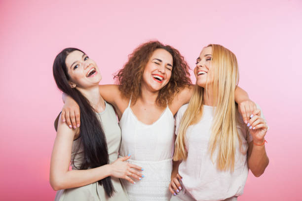 Three young women laughing and having fun stock photo