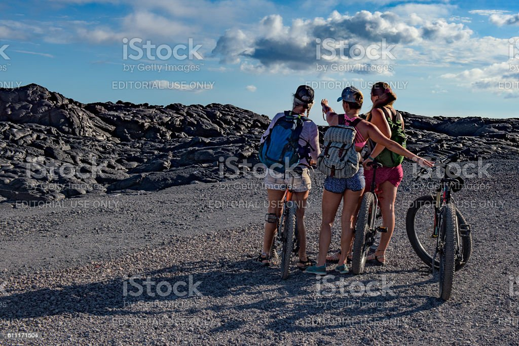 Three young women on the Chain of Craters road stock photo