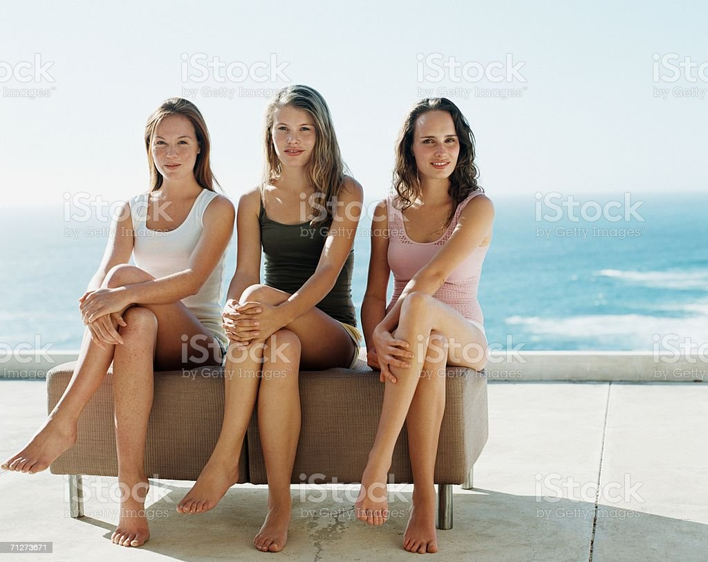 Three young women sat outside royalty-free stock photo