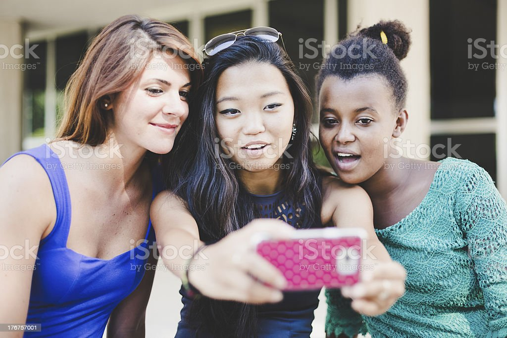Three young women taking self portrait royalty-free stock photo