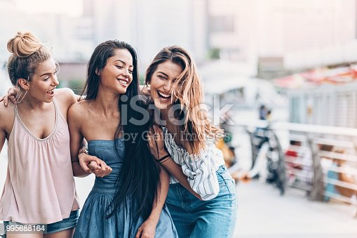 Group of happy girls walking outdoors