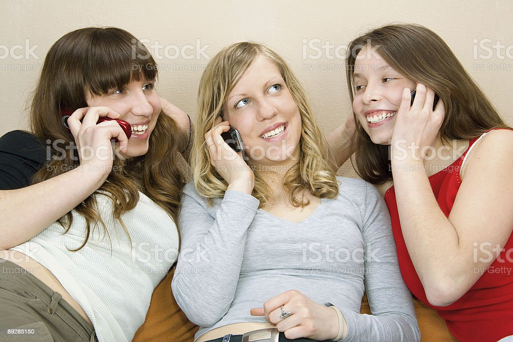 Three Young Women With Phones royalty-free stock photo