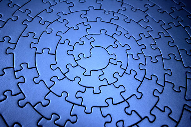 three-dimensional blue jigsaw stock photo