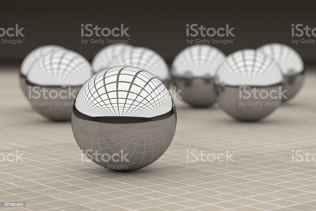 Three-dimensional metal balls reflecting glass ceiling stock photo