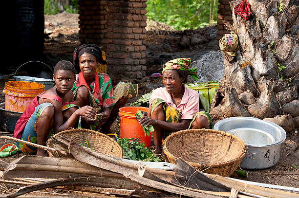 Threee women are working in a palm oil production, Burundi stock photo