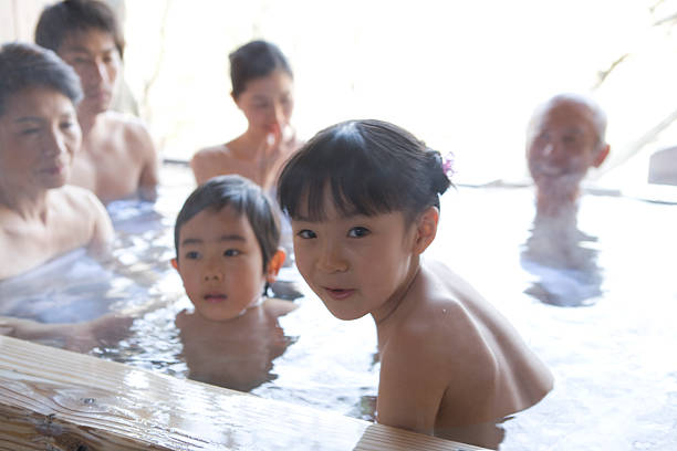 three-generation family in hot spring - japanese bath woman bildbanksfoton och bilder