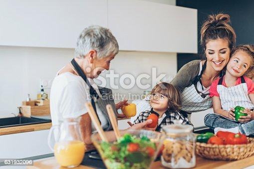 638984280 istock photo Three-generation family in the kitchen 631932096