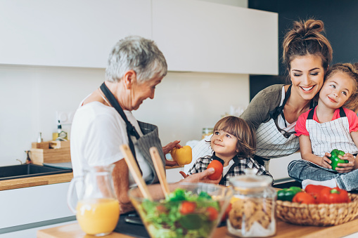 638984280 istock photo Three-generation family in the kitchen 631932096