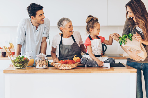 638984280 istock photo Three-generation family in the kitchen 639095748