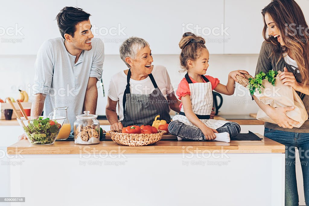Three-generation family in the kitchen stock photo
