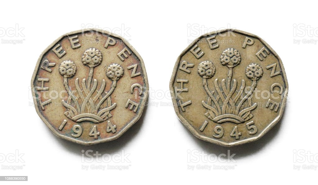 Threepenny bits obverse 1944 1945 old British coin money stock photo