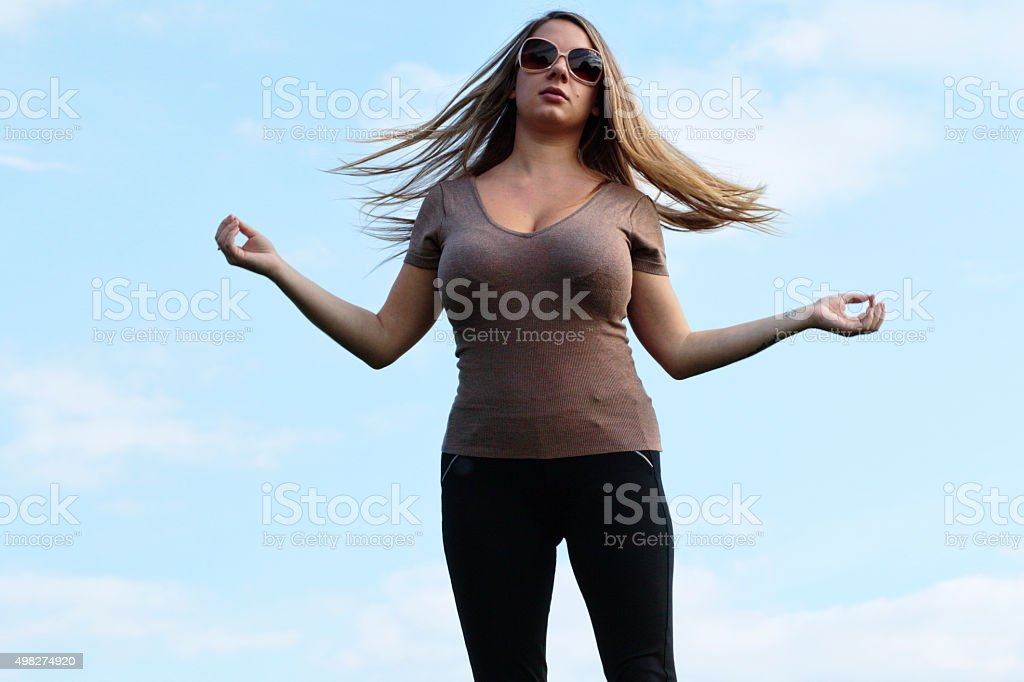 Shapely woman tossing back blonde hair outdoor Polish girl stock photo