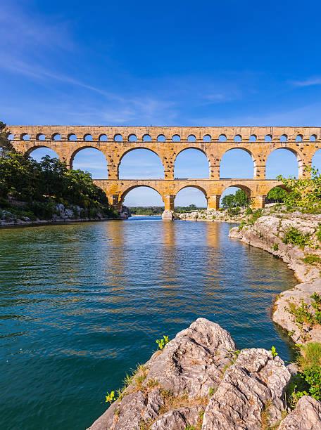 three-storied aqueduct of pont du gard in europe - pont du gard stockfoto's en -beelden