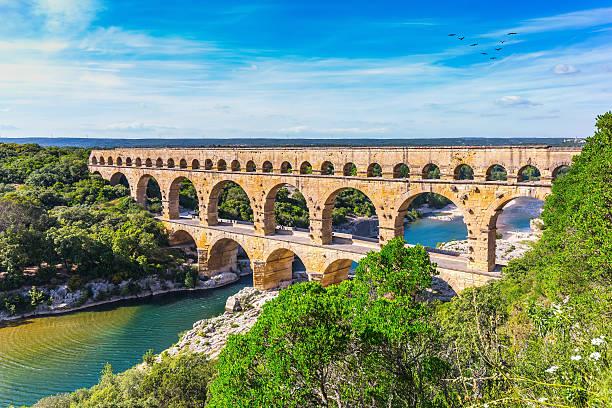 three-tiered aqueduct pont du gard and natural park - pont du gard stockfoto's en -beelden