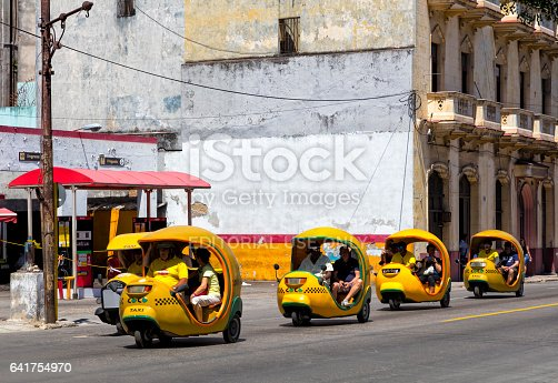 Yellow coco taxis speeding in the old town Havana Vieja, Cuba, motion blur, 50 megapixel image.