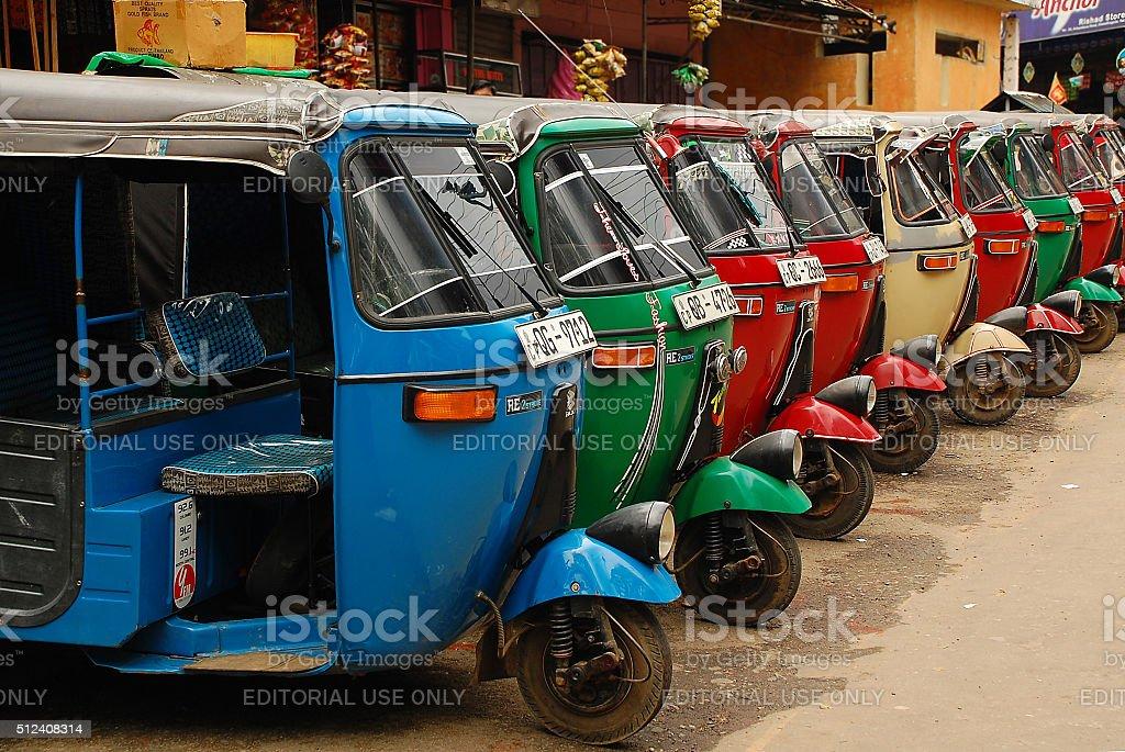 Three-wheelers stock photo