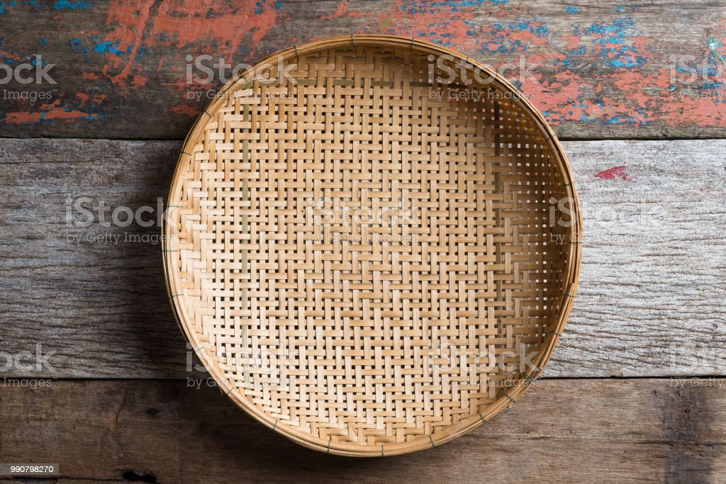 threshing basket on rustic wood background stock photo