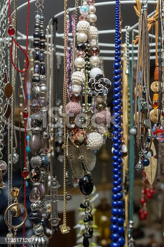 Thrift Costume Jewelry necklaces on turning mill on yard sale
