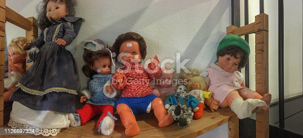 thrift farmyard sale row of priced second hand dolls