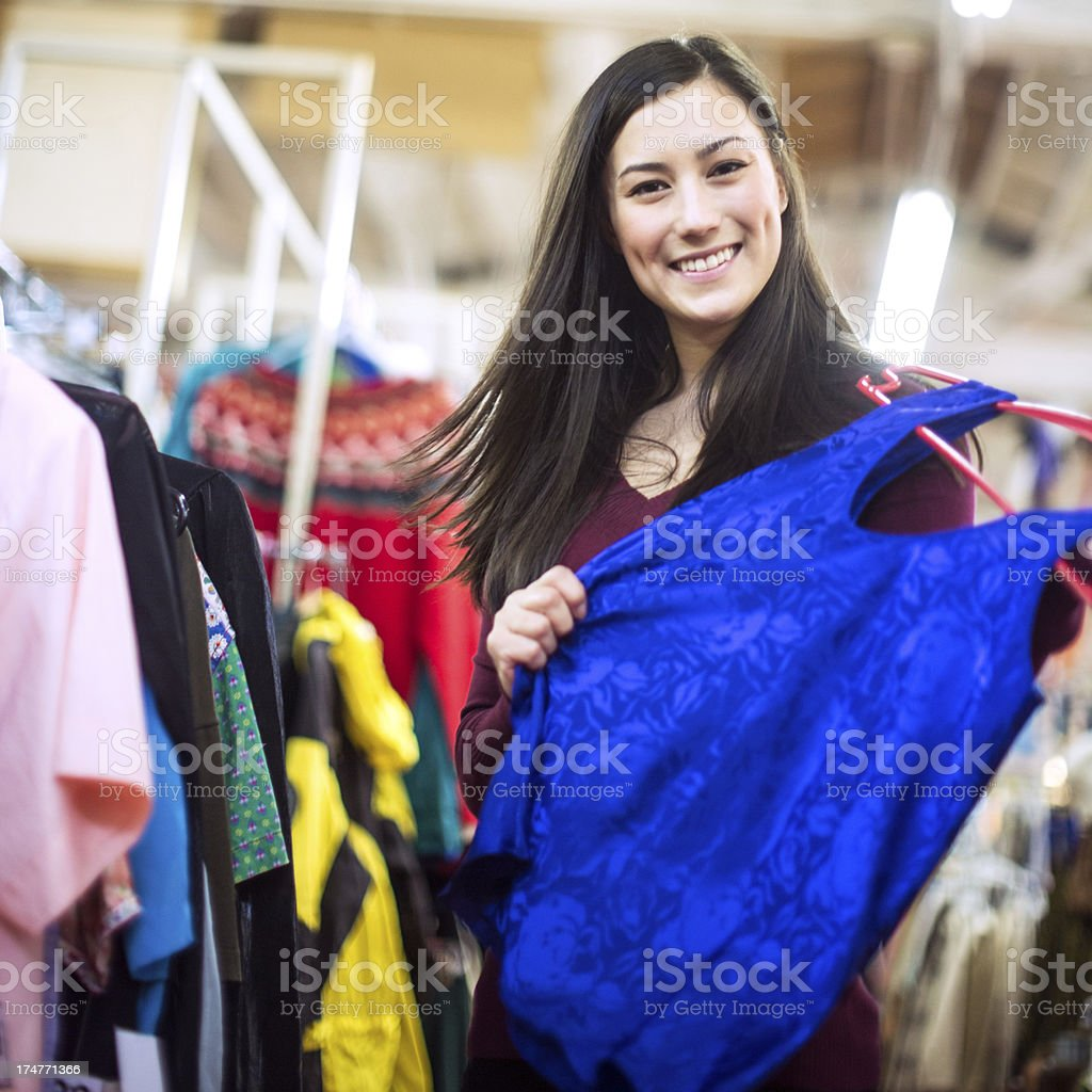 Thrift Store Shopping Young Woman stock photo