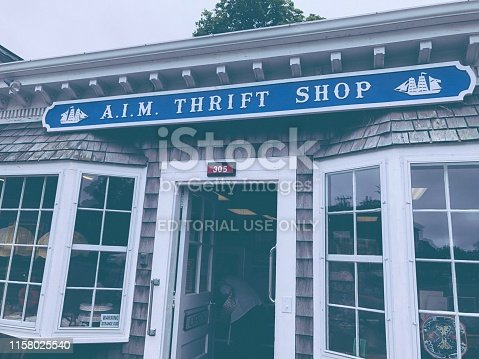 Exploring the local thrift shop in the quaint coastal town of Wellfleet, MA.  A busy clearinghouse for locals and curious tourists.  As seen on June 20, 2019 on the main street in the small town.