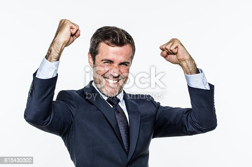 istock thrilled corporate man with elegant suit for success and joy 615430302