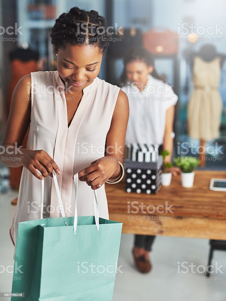 Thrilled with her purchase royalty-free stock photo