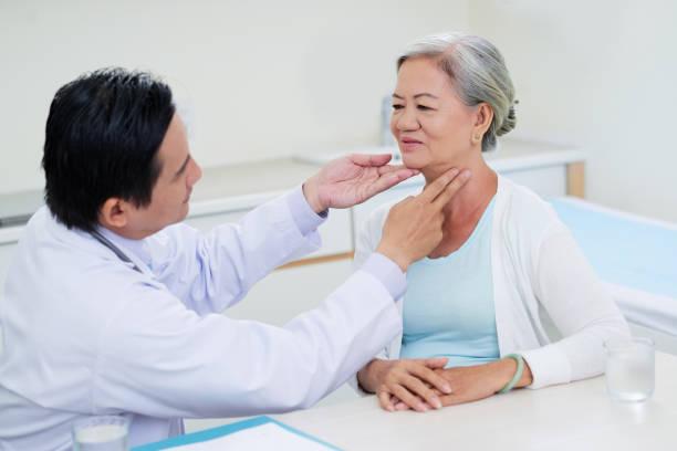 Throat examination stock photo