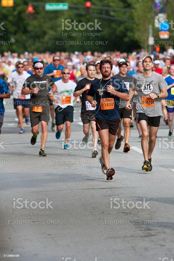 Throng Of Runners Run In July 4 Atlanta Road Race stock photo