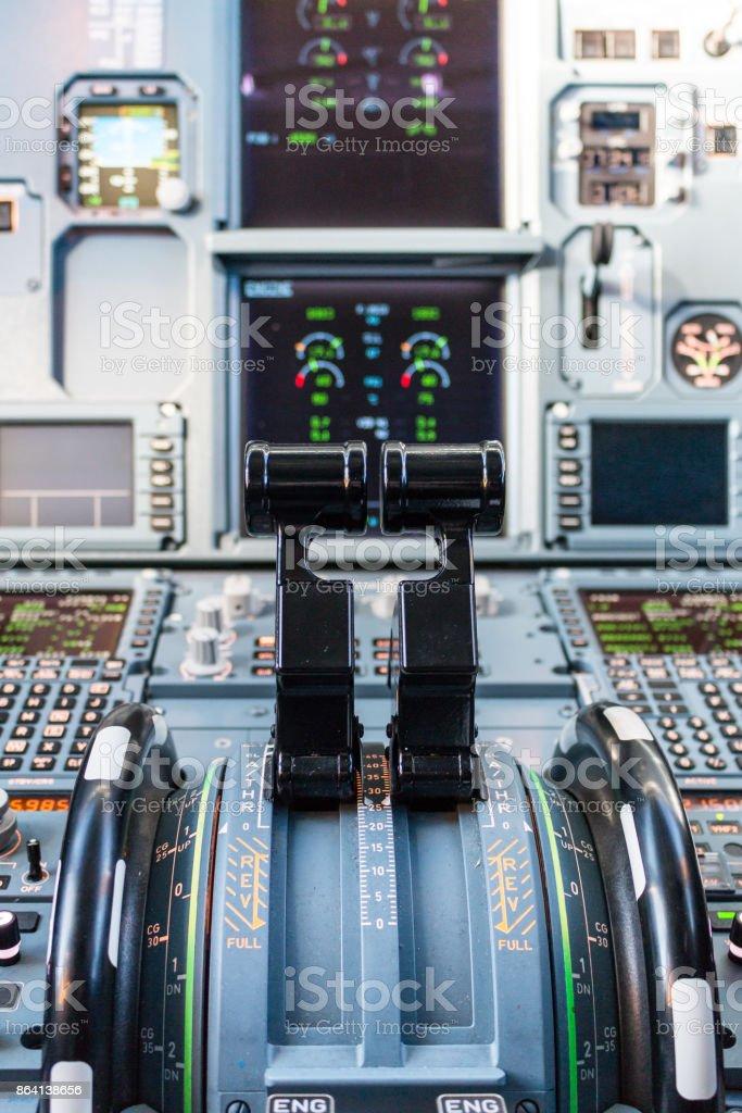 Throttles at full forward thrust in cockpit royalty-free stock photo