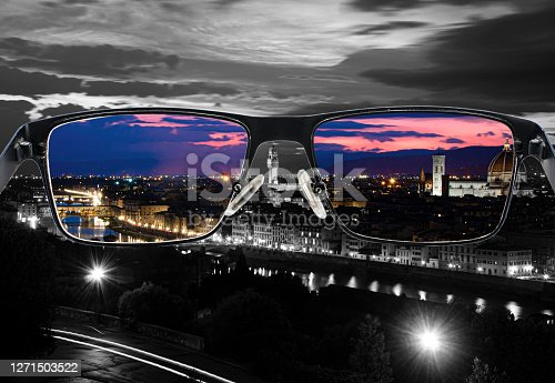 Through glasses frame. Colorful view of Florence night landscape in glasses and monochrome background. Different world perception. Optimism, hopefulness, mental health concept.