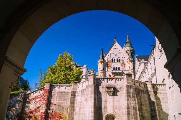 Through the entrance gate of neuschwanstein castle in germany picture id1083639206?b=1&k=6&m=1083639206&s=612x612&w=0&h=zq3uyur0brszdiz7wk eukh1zwh sdbrtanz1czfthk=