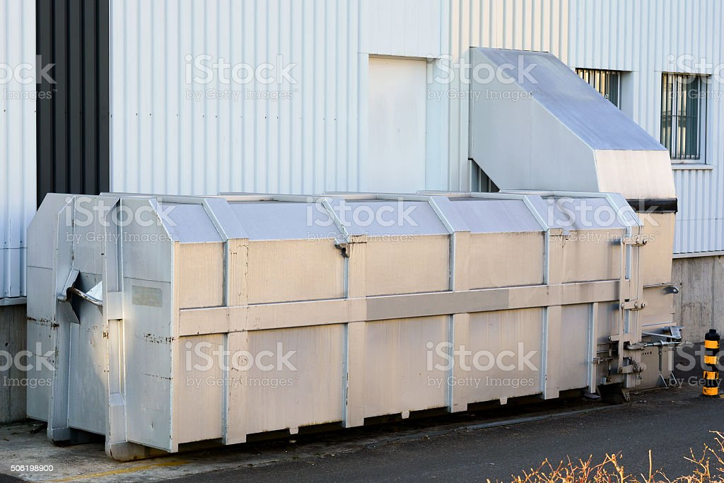 Through the wall compactor waste collector. stock photo