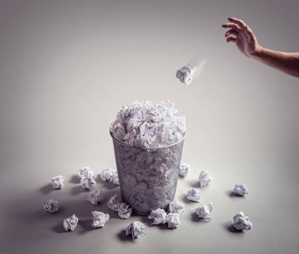 Throw it in the waste paper basket or office bin stock photo