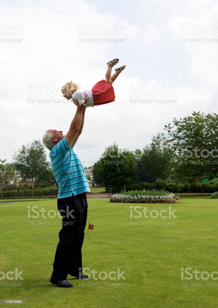 throw me higher grandad royalty-free stock photo
