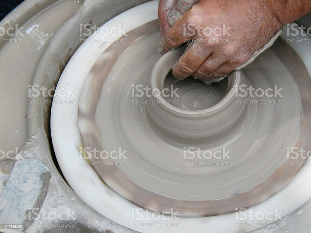throwing a bowl on potter's wheel 2 of 5 royalty-free stock photo