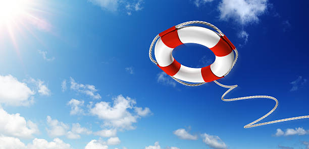Throwing A Life Preserver In The Sky Lifebelt with sunlight and serene sky buoy stock pictures, royalty-free photos & images