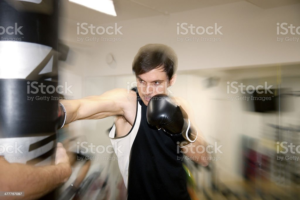 Throwing a punch stock photo