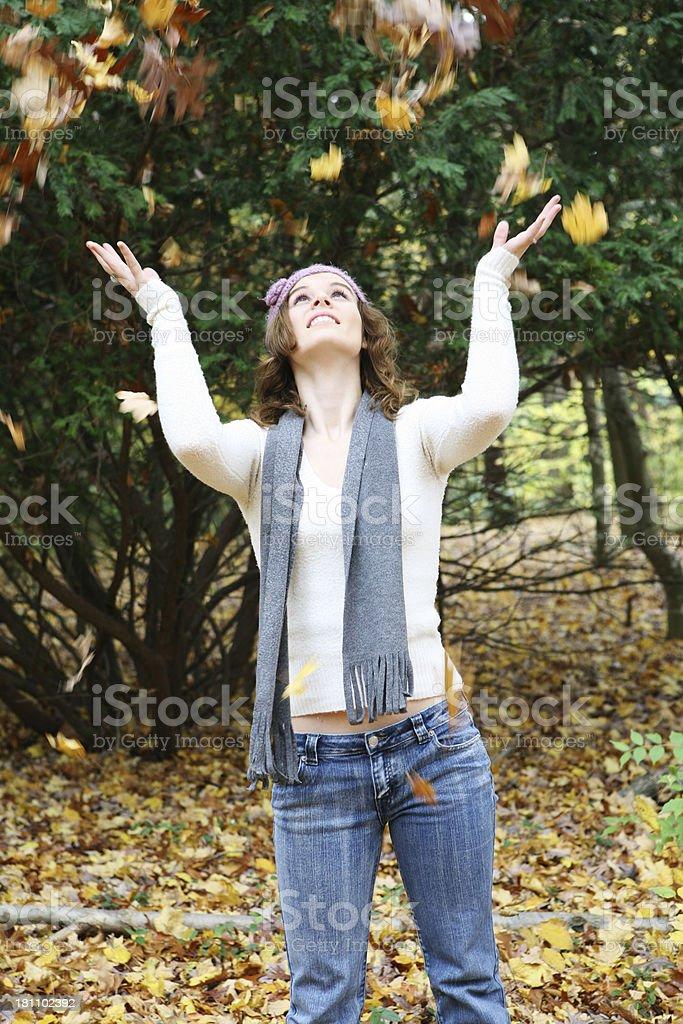 Throwing autumn leaves royalty-free stock photo
