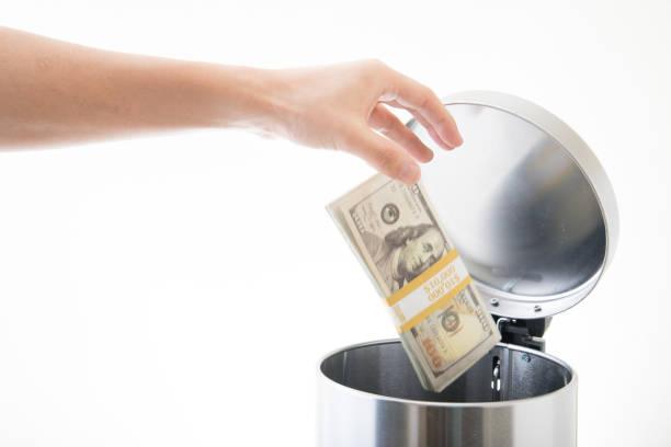 throwing away ten thousands dollars - throw money away stock pictures, royalty-free photos & images