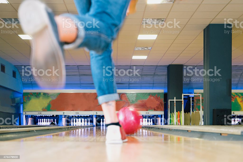 Bowling while throwing bowling ball.